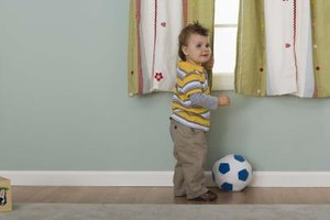 Clearing the area below the window of furniture makes it more difficult for your toddler to climb out.