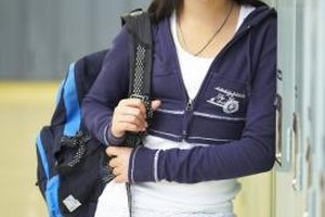 Denim jeans paired with a T-shirt and sweater is an ideal outfit for the eighth grade.