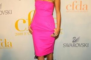 Actress Blake Lively rocks a bright fuchsia dress with nude open-toe pumps for a chic finish.