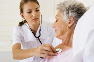 A nurse performs a routine checkup.