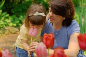 Taking time to stop and smell the flowers will help your toddler practice differentiating scents.