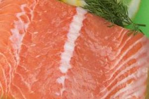 Season salmon prior to steaming.