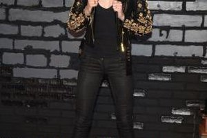 Model Coco Rocha pairs an embellished leather jacket, a sexy tank and heels with her skinny jeans for a look that's worthy of ringing in the New Year.