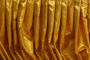 Shiny gold fabric helps create an inexpensive costume.