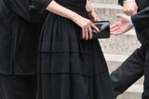 Model Claudia Schiffer in a conservative black ensemble at the funeral of composer Marvin Hamlisch.