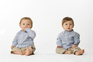 Your twin six-month-olds may begin to sit up on their own.