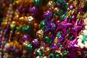 Have plenty of Mardi Gras beads on hand for the party.