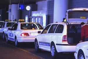 Taxi cab services make public transportation more flexible and efficient.