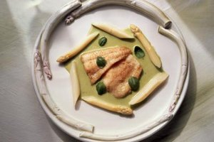 Pair oven-baked turbot fillets with a delicate herb sauce.
