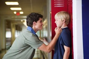 You cannot punish a bully for his behavior, but you can find laws that will help you, even if his parents won't.