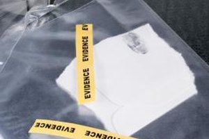 Forensic analysts may work crime scenes, examining evidence.