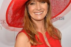 Actress Jane Seymour goes all out with an attention-grabbing wide-brimmed red hat at the Kentucky Derby in May 2013.