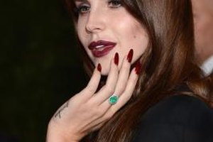 Lana Del Rey sports maroon lipstick at the Met in New York City.