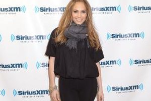 Jennifer Lopez embraces her curves by wearing a pair of black leggings.