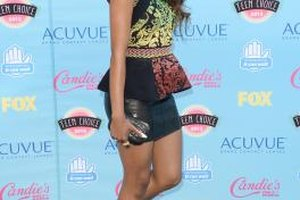 Actress Katerina Graham glams up her miniskirt look with stiletto pumps.