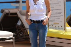 Marta Sandoval looks summery in a white sleeveless blouse and light blue jeans at the Diageo Reserve World Class Global Final in 2013.