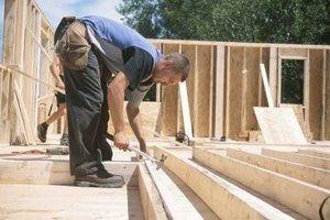 Journeyman carpenters work at new home sites and other construction projects.