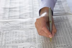 A data entry clerk may extract data from a document such as a newspaper.
