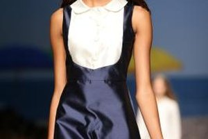 Create a '60s-inspired look wearing color-blocked navy dresses.