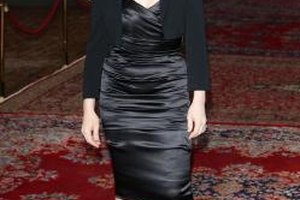 Take a page from Juliette Binoche's book and showcase your satin tube dress with a classic bolero jacket.