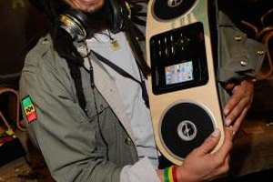 A Consumer Electronics Show 2011 vendor bumps tunes on an iPhone boombox.