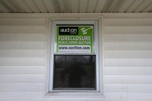 Unsold foreclosures are usually sold at auction or by real estate agents.