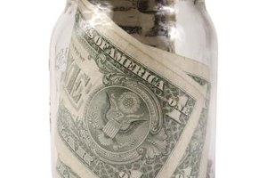 You pay taxes on money in a jar when you earn it. No interest earned equals no additional taxes.