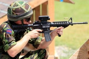 The M4 carbine is sometimes fired from the kneeling position.
