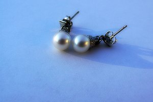 Marines may wear small, stud, pearl-style earrings.