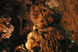 Discover hanging rock formations while caving near Galena.