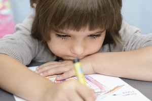 Close-up of young child coloring