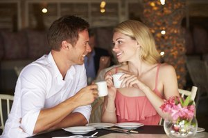 Couple staring into each others' eyes in cafe