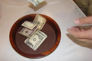 Close-up of tithing plate.