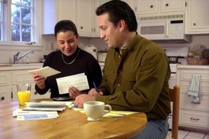 Couple doing finances in the kitchen