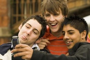 Group of teen boys taking a photo