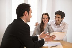 A married couple consults with a tax professional