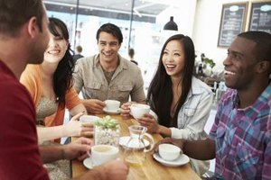 A group of friends hang out in a coffeehouse together to socialize.