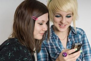 Teenagers often feel that a cell phone is an important priority so they can communicate regularly with friends.