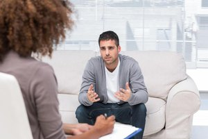 Man talking to a counsellor.