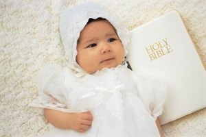 Many christening gown ensembles include a white bonnet.