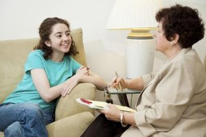 Teenage girl receiving counseling.
