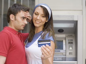 Does the Extra Cardholder on a Credit Card Application Get His Credit Run Also?