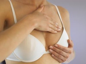 Exercises to Decrease Breast Size & Tighten the Stomach Muscles