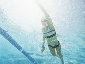 Flutter-Kicking Swimming Exercises That Tighten Abs