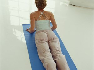 Back Hyperextensions on the Floor Without Using Your Legs