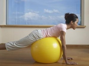 Exercise Ball Exercises to Loosen the Hip Abductor Muscles