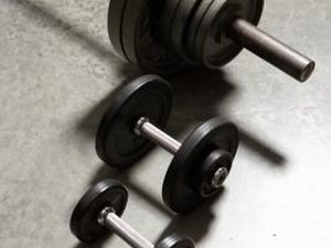Dumbbell Vs. Barbell for Strength Training for MMA