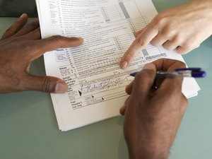 Can I Claim Land & County Taxes on My Tax Return Form?