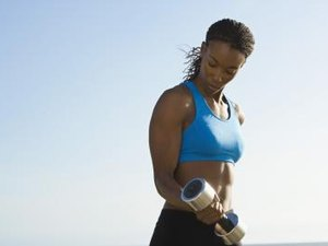 How to Do Dumbbell Chops for Women