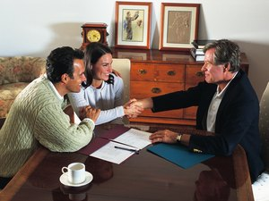 Advantages & Disadvantages of Paying Your Homeowner's Insurance Up-Front or at a Closing